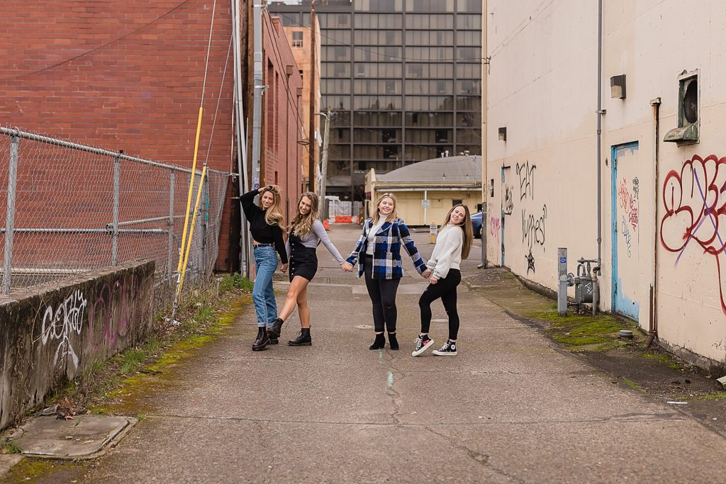Senior girls walking around the city of Eugene Oregon
