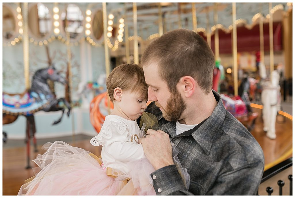 One year old with father at birthday party at Carousel Museum in Albany Oregon