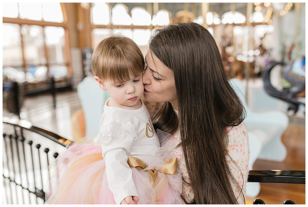 One year old with mother at birthday party at Carousel Museum in Albany Oregon