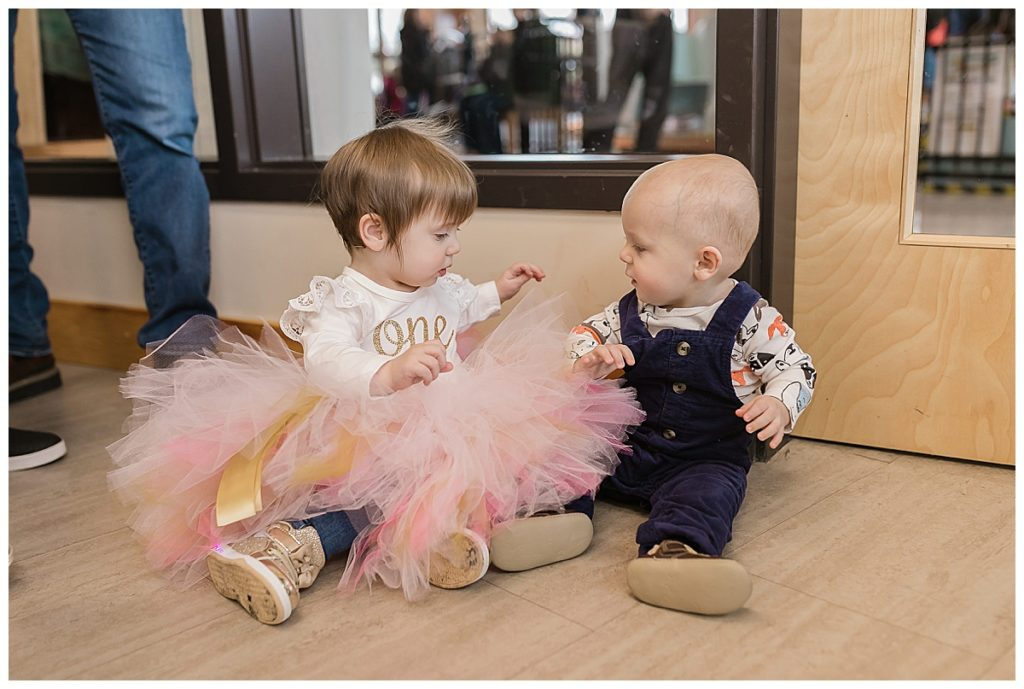 One year old boy and girl at birthday party at Carousel Museum in Albany Oregon